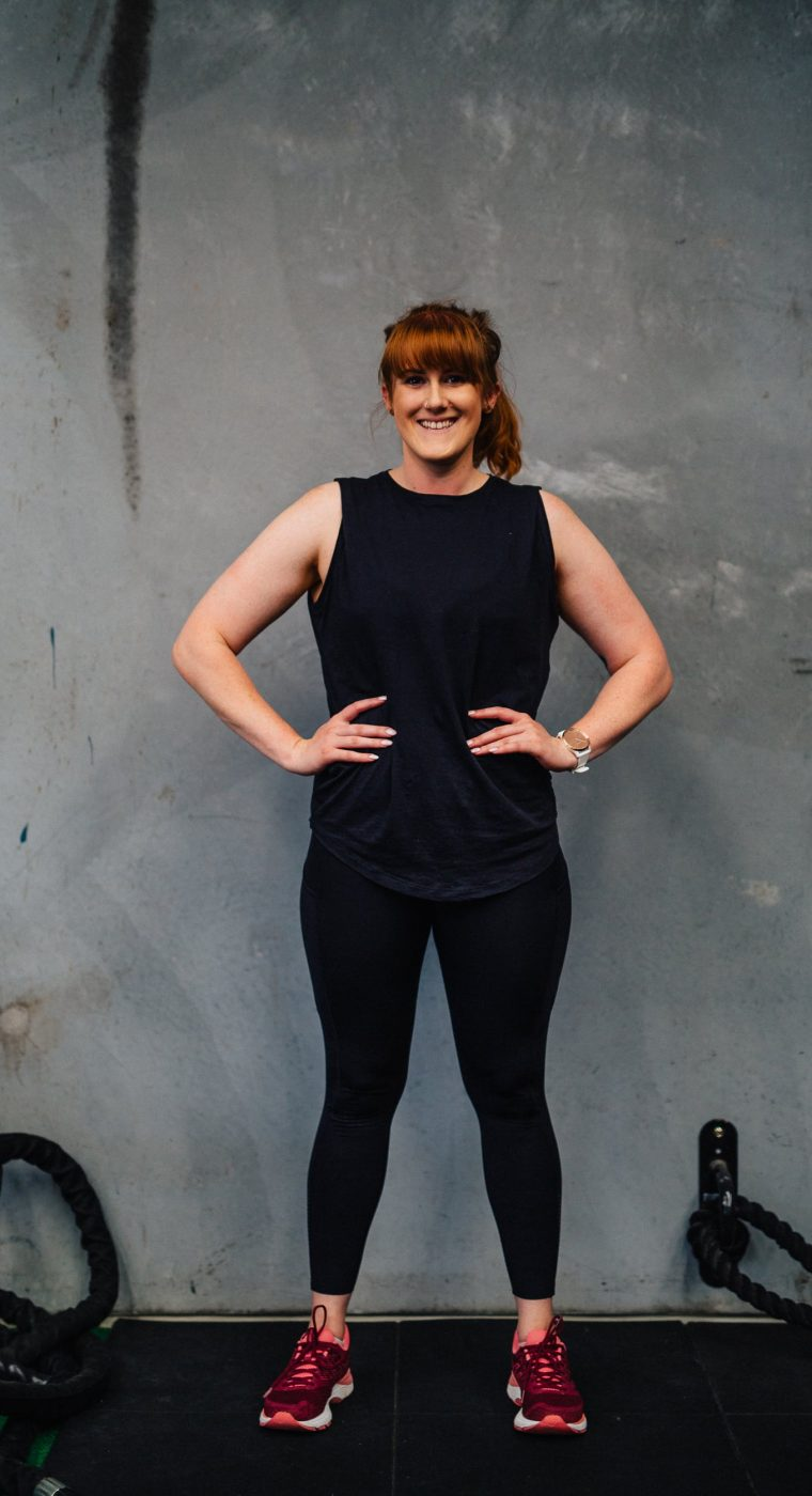 Smiling woman with her hands on her hips