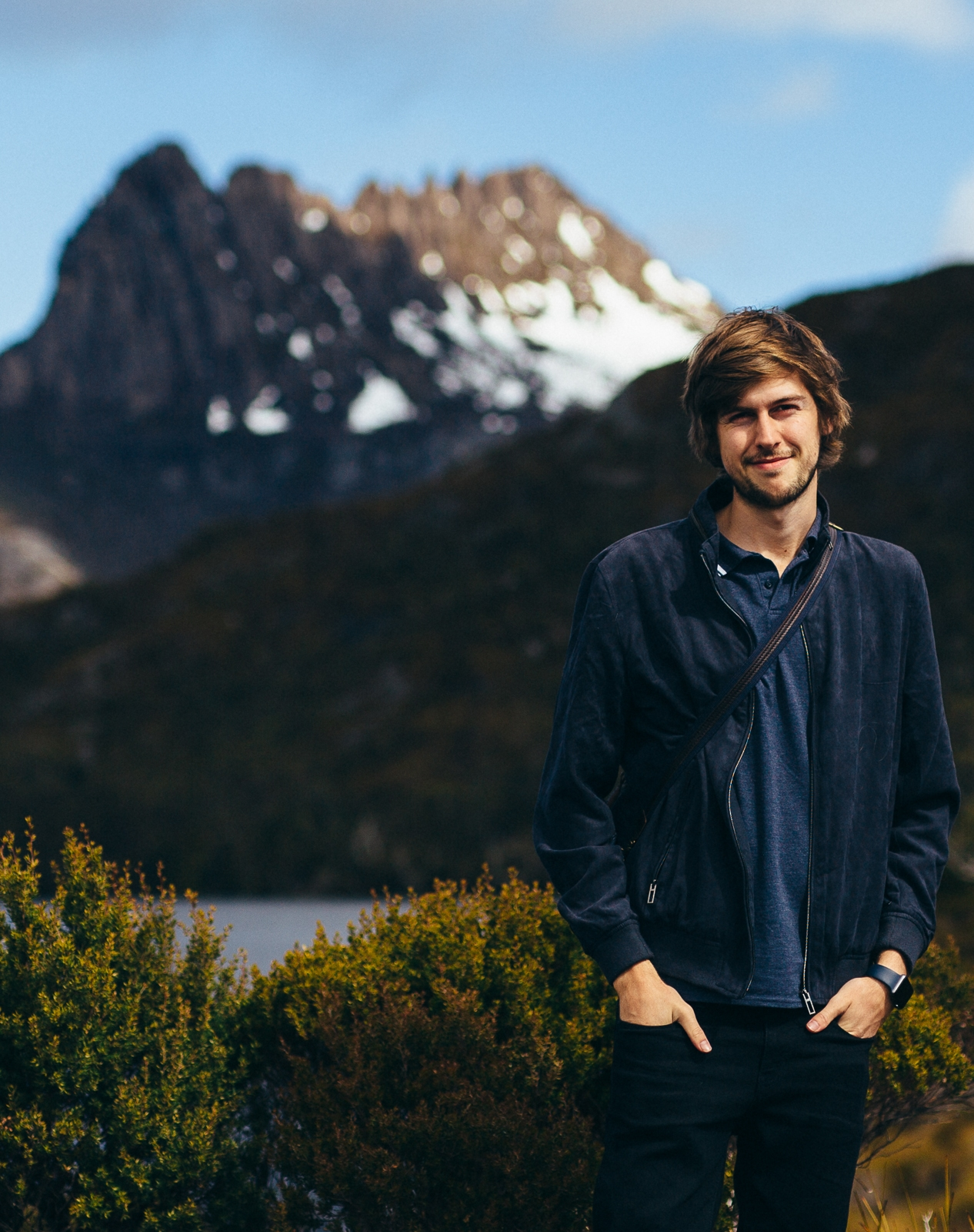 Samuel Brooks standing in front of Cradle Mountain